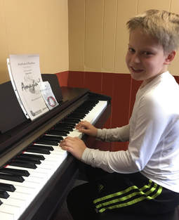 student achievment rewards for piano and guitar lessons in moscow, id