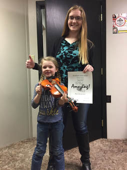 Happy violin student and teacher ...